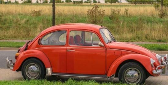 Image of an orange VW Beetle